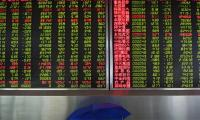 Asian markets lifted by China-US trade hopes, pound stands ground
