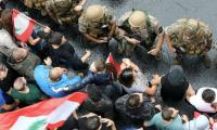 Lebanese protesters face off against army as demos continue