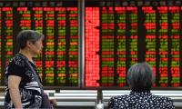 Asian markets mixed as dealers await trade news, Hong Kong rises
