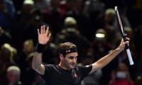 Federer stays alive at ATP Finals with Berrettini win
