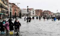 Venice hit by record high tide, floods
