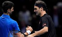 Federer outclasses Djokovic to reach last four of ATP Finals