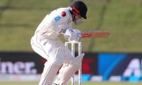 Henry Nicholls under medical supervision for concussion before return to crease