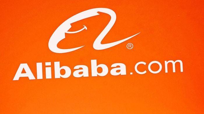 Alibaba shares surge more than 6% on Hong Kong debut