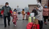 First coronavirus death reported in Beijing as death toll in China passes 100