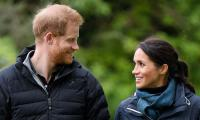 Harry and Meghan Markle are smitten with each other despite the royal exit drama