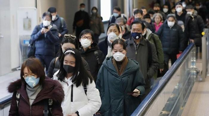 WHO urges calm as coronavirus death toll in China hits 2,000