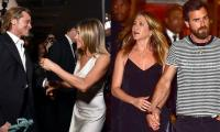 Jennifer Aniston still tugs at Justin Theroux and Brad Pitt's heartstrings?