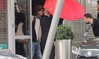 Brad Pitt in blue ripped jeans takes away hearts in rainy scene
