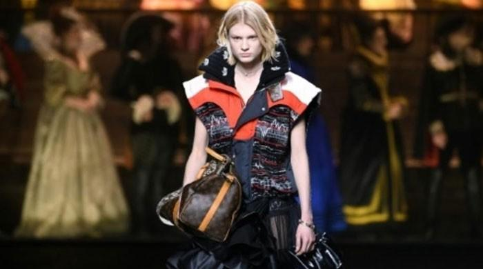 Louis Vuitton hits high note with all-singing Paris fashion show