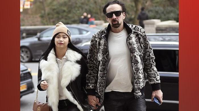 Nicolas Cage walks hand in hand with girlfriend Riko