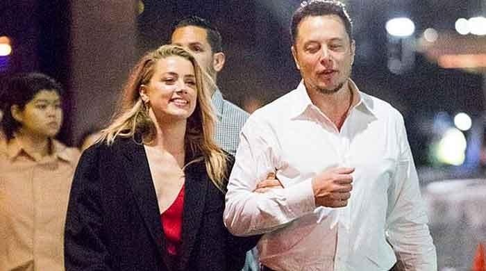 Johnny Depp fans think new surveillance tape shows Amber Heard cheated on him with Elon Musk