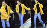 Bella Hadid dazzles in yellow jacket and blue jeans as she steps out of self-isolation