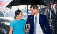 Prince Harry, Meghan Markle's iconic rain shot explained by photographer Samir Hussein
