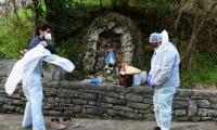 Europe's coronavirus death toll surges past 20,000, Chinese epicentre Wuhan partially reopens