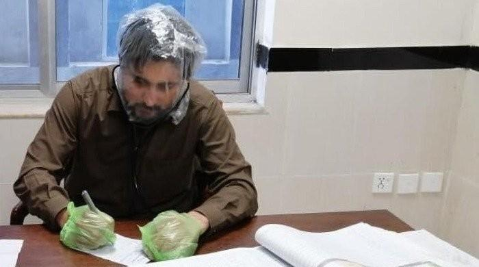 KP government takes back inquiry against doctor who wore plastic bag over head