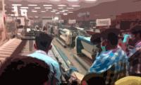 Karachi police seal textile mills for violating coronavirus lockdown orders