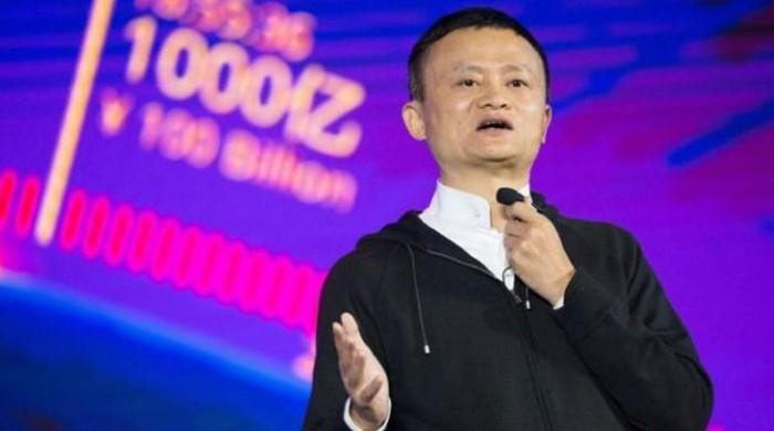 SoftBank Group reports record losses as Jack Ma quits board