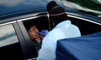 US COVID-19 death toll tops 100,000