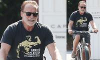 Arnold Schwarzenegger looks dashing as he enjoys bike ride with pal Ralf Moeller