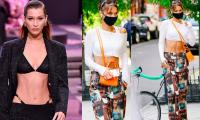 Bella Hadid slays in Playboy trousers and crop top