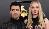 Sophie Turner cradles baby bump during stroll with husband Joe Jonas