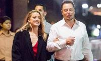 Amber Heard was seen 'bruised after Elon Musk's visit' while Johnny Depp was away
