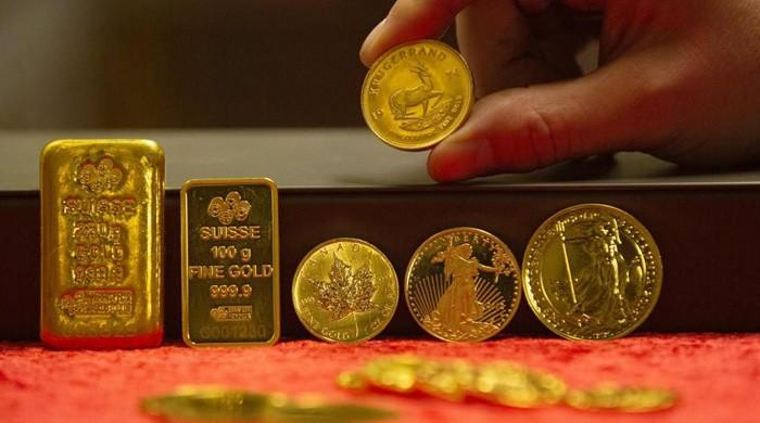 Gold forges record high as investors rush into safe-haven commodity
