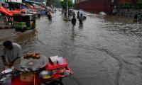 In pictures: Torrential rains wreak havoc in Lahore, flood roads