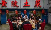 Chinese restaurant apologises for weighing diners