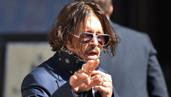 Johnny Depp wants delay in defamation trial to film `Fantastic Beasts 3`