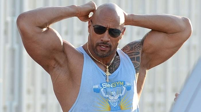 Dwayne 'The Rock' Johnson rips apart electric security gate after power failure leaves him trapped