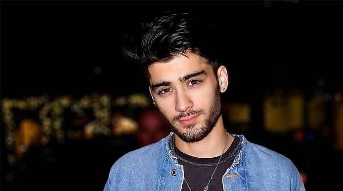 Zayn Malik is promoting 'Harry Potter Puzzles And Spells'