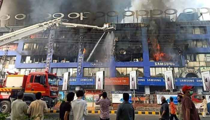 Huge fire guts several shops at Lahore's Hafeez Center