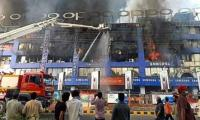 In pictures: Lahore Hafeez Centre fire rages on