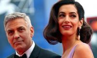 George Clooney says Amal kept him on his knees for 20 minutes after he proposed