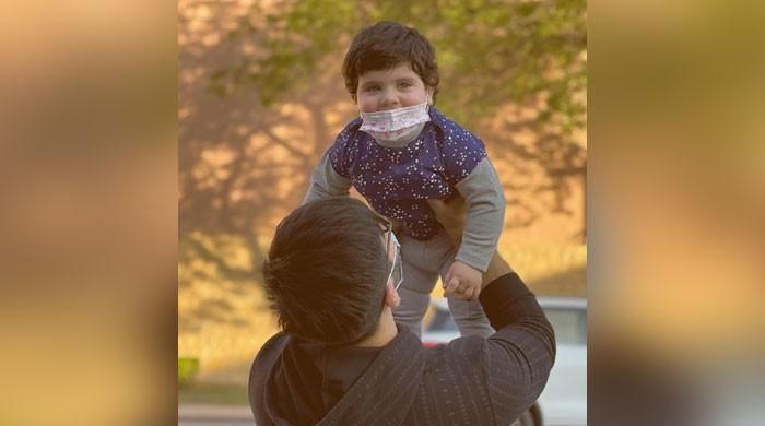 Aiman Khan touches fans' hearts with snap of Muneeb Butt, daughter Amal