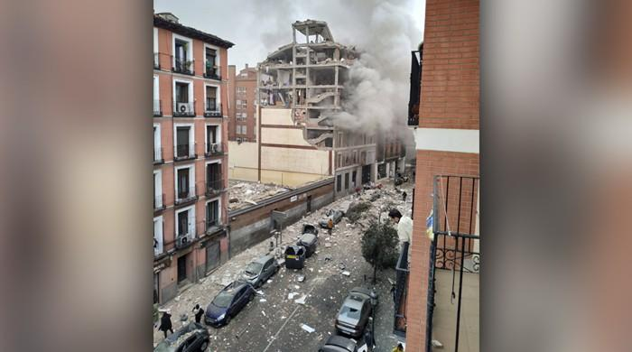 A bomb blast near the Spanish capital has killed at least two people and injured dozens more