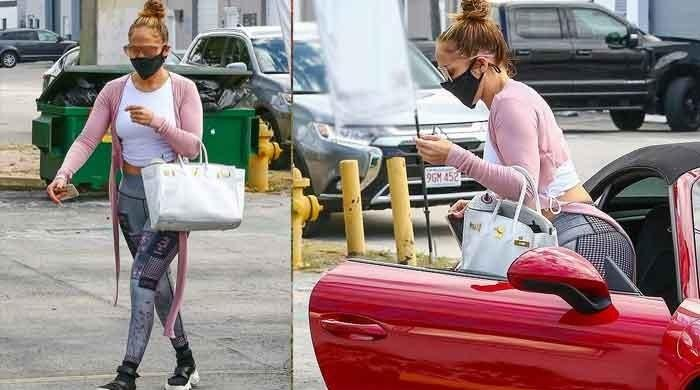 Jennifer Lopez flaunts her perfect curves in crop top and snug leggings during her latest outing