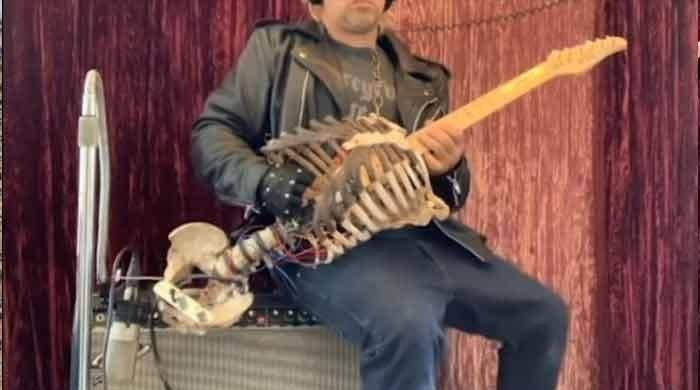 A musician makes guitar from his dead uncle's skeleton
