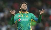 Shahid Afridi wonders why ICC won't allow umpires to hold bowlers' caps