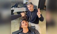 Kim Kardashian caught napping while getting her hair done