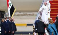 'Happy' Pope Francis lands in Iraq on historic visit