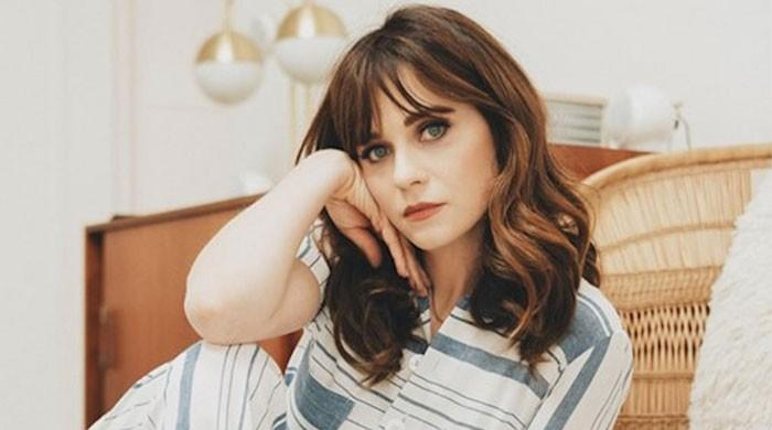 Zooey Deschanel ditches her signature bangs to 'prove she has a forehead'