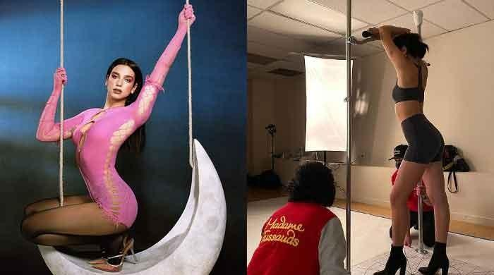 Dua Lipa poses for Madame Tussauds waxwork after three BRIT Awards nods