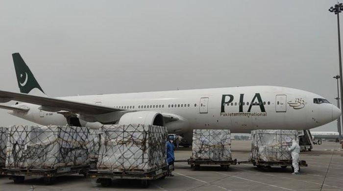 The PIA plane arrived from China carrying more than 300,000 doses of vaccine