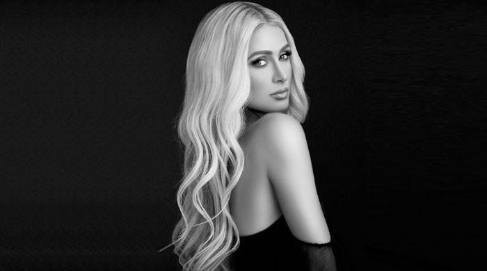 Paris Hilton addresses concerns over 'stop being poor' shirt