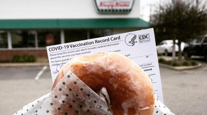 Biden encourages Americans to get COVID shots with free doughnuts