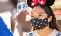 Disney to relax temperature screening at themed parks as pandemic eases
