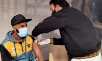 How many Pakistani players were vaccinated against coronavirus by PCB?